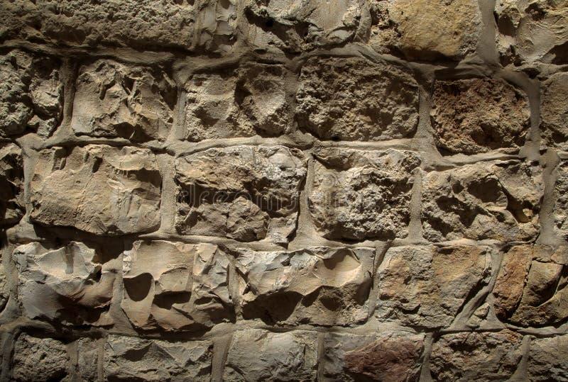 Textura da parede de pedra do claro-escuro imagem de stock royalty free