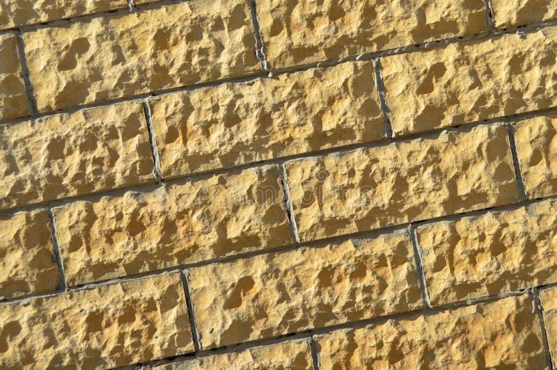Parede de pedra bege de corte de multa Fundo, textura imagem de stock