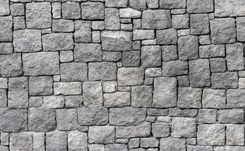 Parede de pedra cinzenta velha, textura sem emenda do fundo