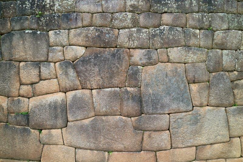 A parede de pedra com a citadela antiga original de Inca Stonework Inside Machu Picchu, Cusco, Urubamba, local arqueológico no Pe fotografia de stock