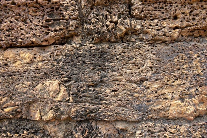 Parede de pedra contínua Close up alaranjado dos tijolos Fundo sujo resistido da foto da parede de tijolo Textura afligida do are imagem de stock