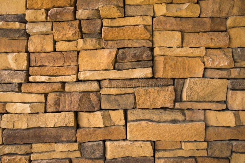 Parede de pedra da textura e de alvenaria da construção, fundo abstrato fotos de stock royalty free