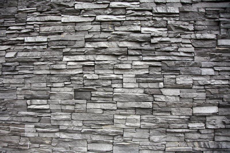 Parede de pedra empilhada com alturas diferentes imagem de stock