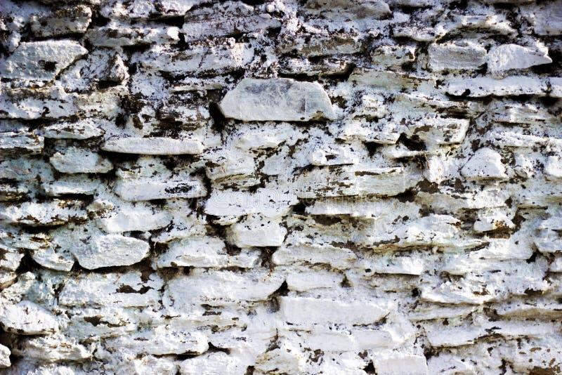 Parede de pedra mergulhada cal da cortina da alvenaria imagem de stock