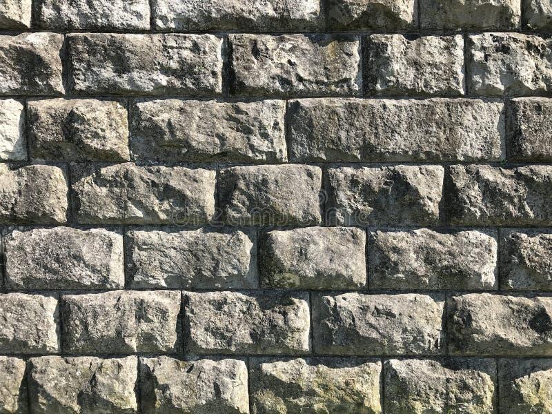 Parede de pedra velha Textura e fundo rústicos imagens de stock royalty free