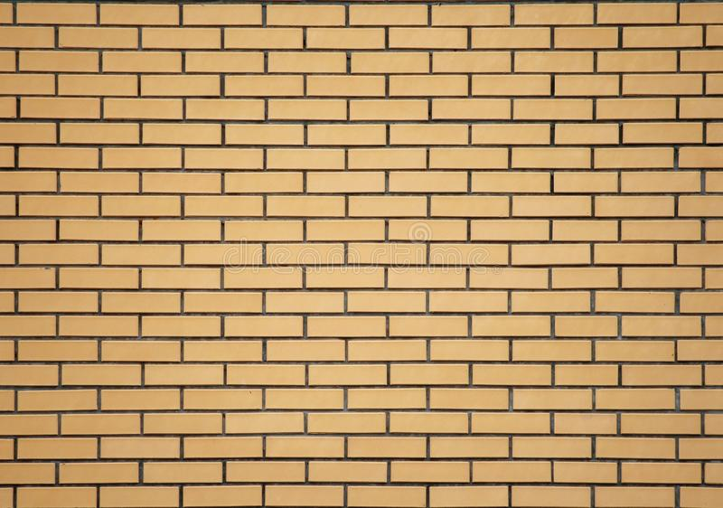 Parede de tijolo amarela fotos de stock