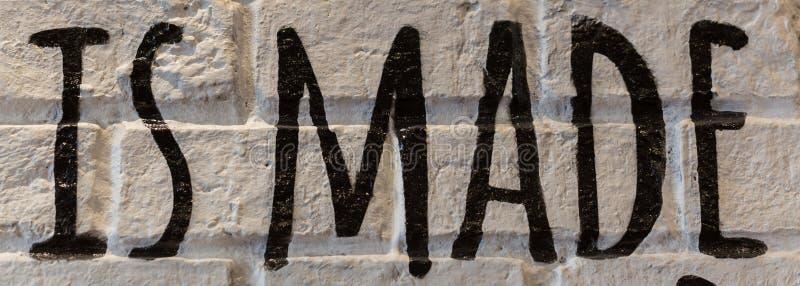 Parede de tijolo branca bonita no restaurante Tenha letras e palavras foto de stock