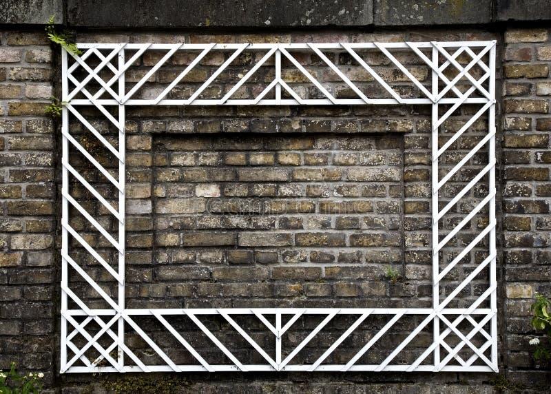Parede de tijolo com frame branco foto de stock