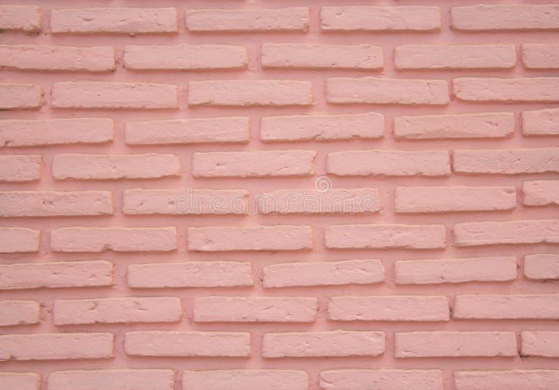 Parede de tijolo cor-de-rosa da textura no dia fotos de stock