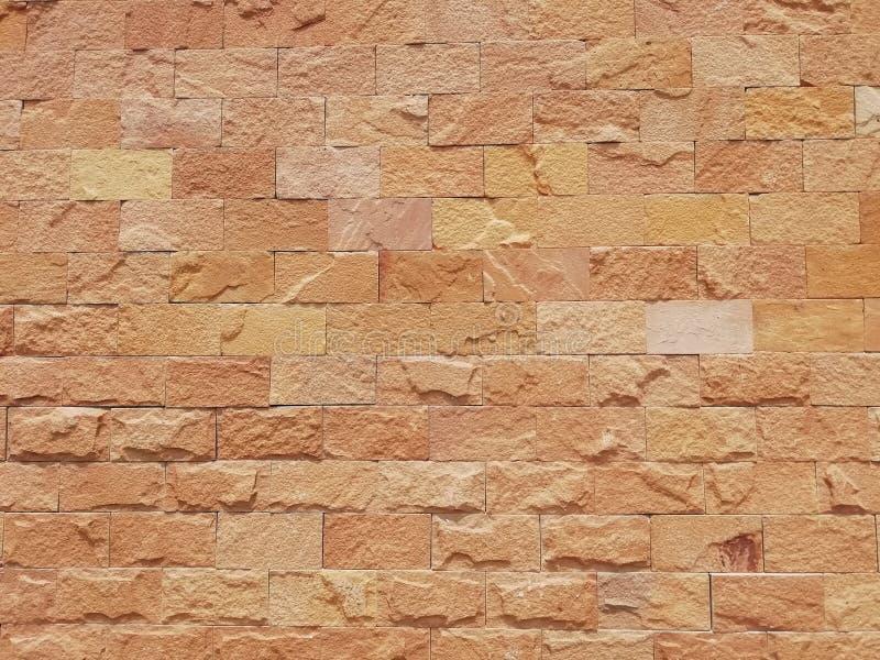 Parede de tijolo da cor vermelha, do panorama largo da alvenaria, da textura velha do papel do vintage ou do fundo foto de stock