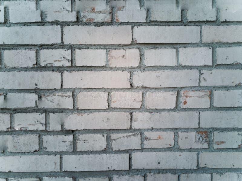 Parede de tijolo danificada velha fotografia de stock