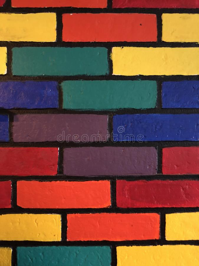 Parede de tijolo multicolorido fotos de stock royalty free