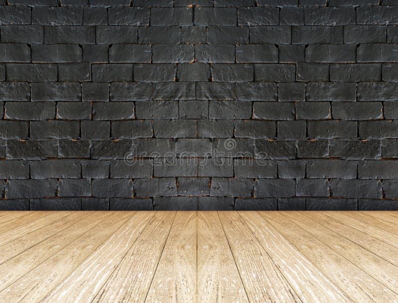 Parede de tijolo preta e assoalho de madeira imagens de stock royalty free