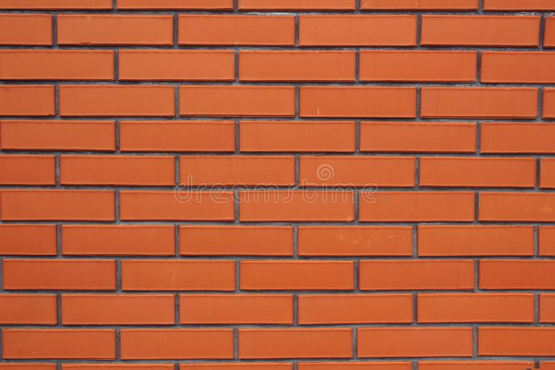 A parede de tijolo vermelha, marrom textured o fundo fotografia de stock