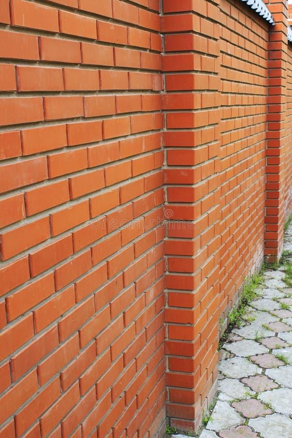 A parede de tijolo vermelha, marrom textured o fundo imagens de stock royalty free