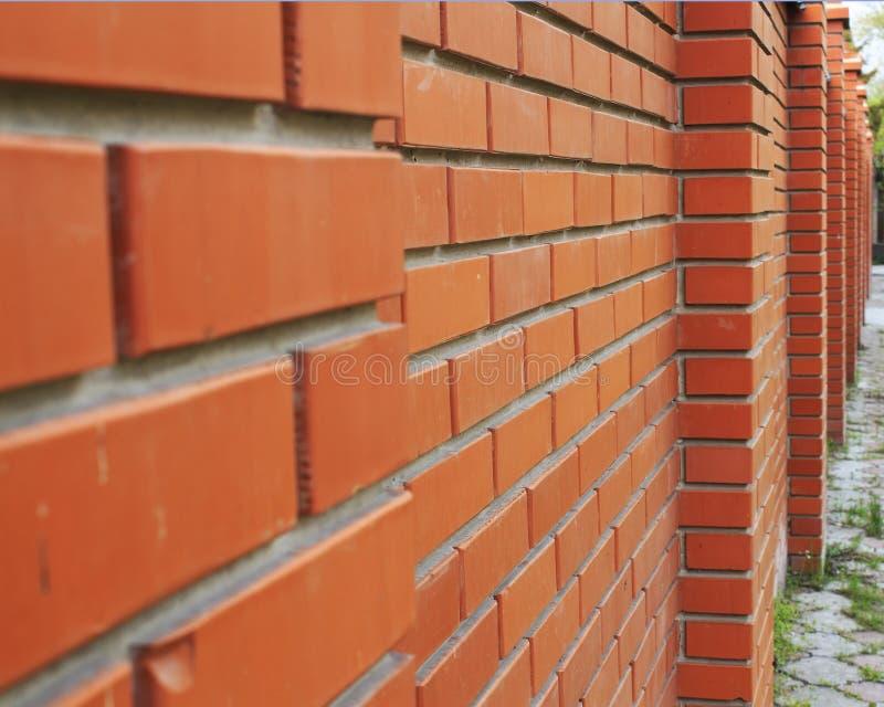 A parede de tijolo vermelha, marrom textured o fundo foto de stock