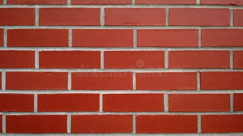 Parede de tijolo vermelho nova para o fundo ou a textura imagens de stock