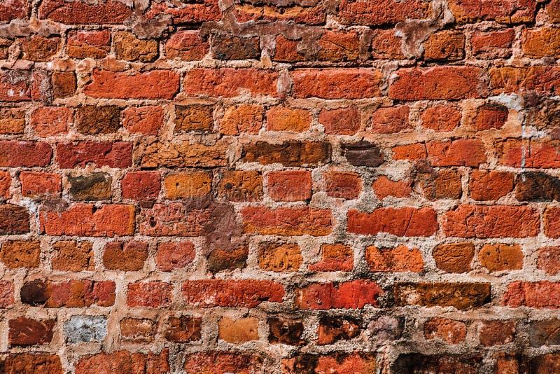 Parede de tijolo vermelho velha, fundo do grunge fotografia de stock