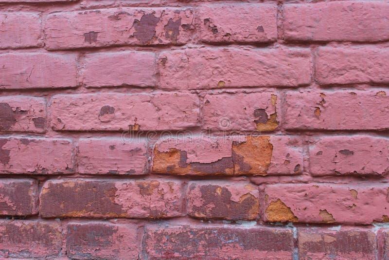Parede de tijolos cor-de-rosa velha, fundo do grunge fotografia de stock royalty free