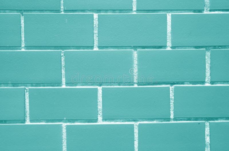 Parede de tijolos na cor do azul de gelo, fechado acima para o fundo imagem de stock