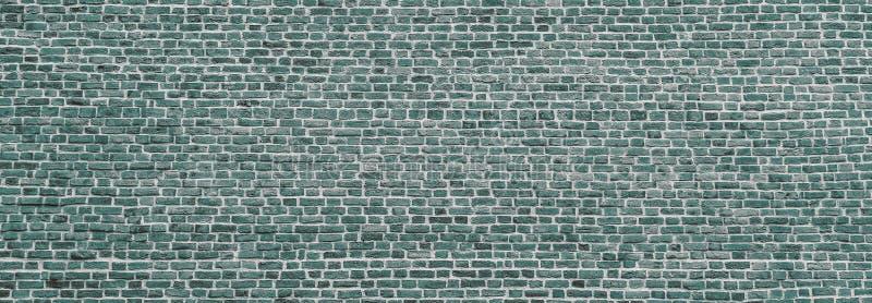 Parede de tijolos, panorama amplo da alvenaria da cor da menta Parede com tijolos pequenos Design moderno de papel de parede para imagens de stock