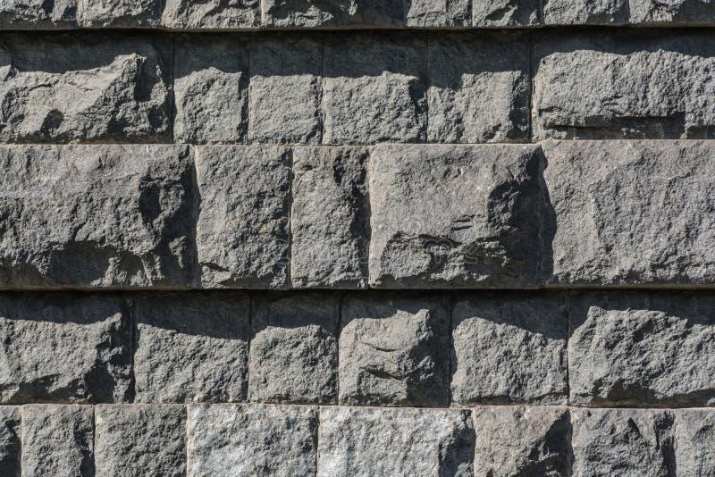 Parede de tijolos pretos do granito foto de stock