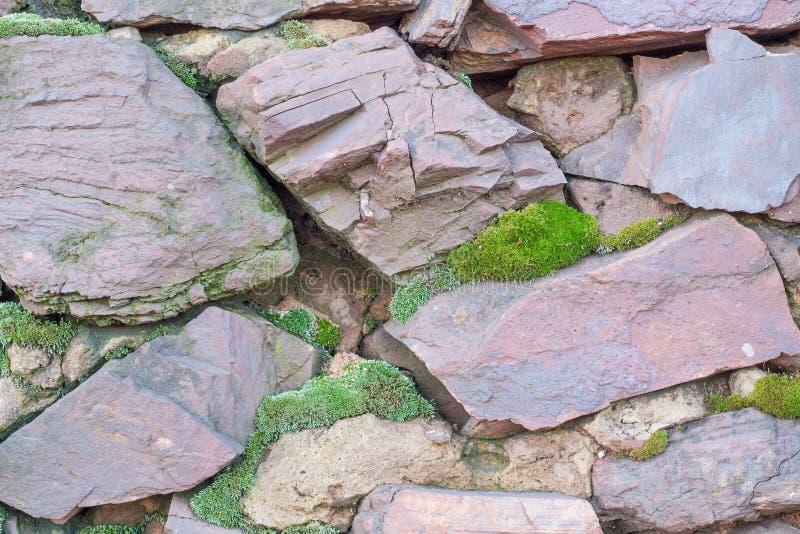 Parede de uma pedra áspera fotografia de stock