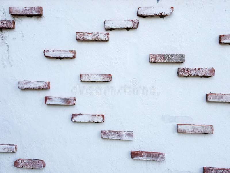 Parede do cimento branco com tijolos Fundo textured da pedra abstrata do grunge fotos de stock royalty free