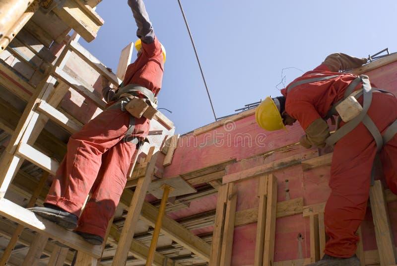 Parede do edifício do trabalhador da construção - horizontal imagem de stock