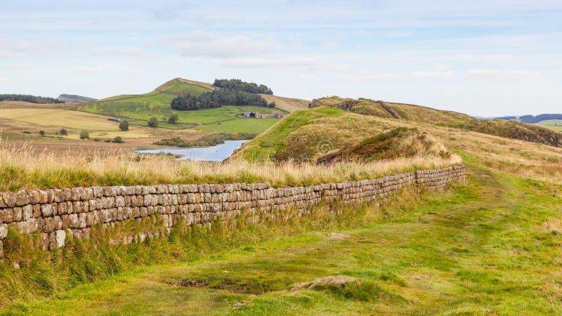 Parede do ` s de Hadrian em Northumberland imagem de stock