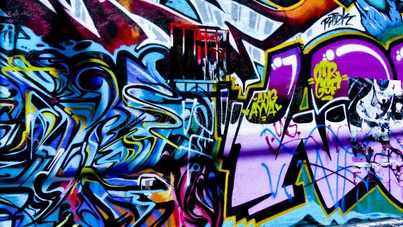 Parede dos grafittis foto de stock