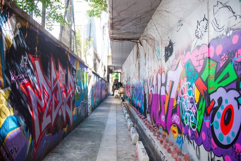 A parede dos grafittis de Mongkok da fama é ficada situada não longe do estreptococo de Argyle imagens de stock royalty free
