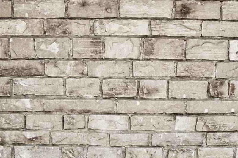 Parede dos tijolos cinzentos de pedra, fundo abstrato Edif?cio da parede de tijolo fotografia de stock royalty free