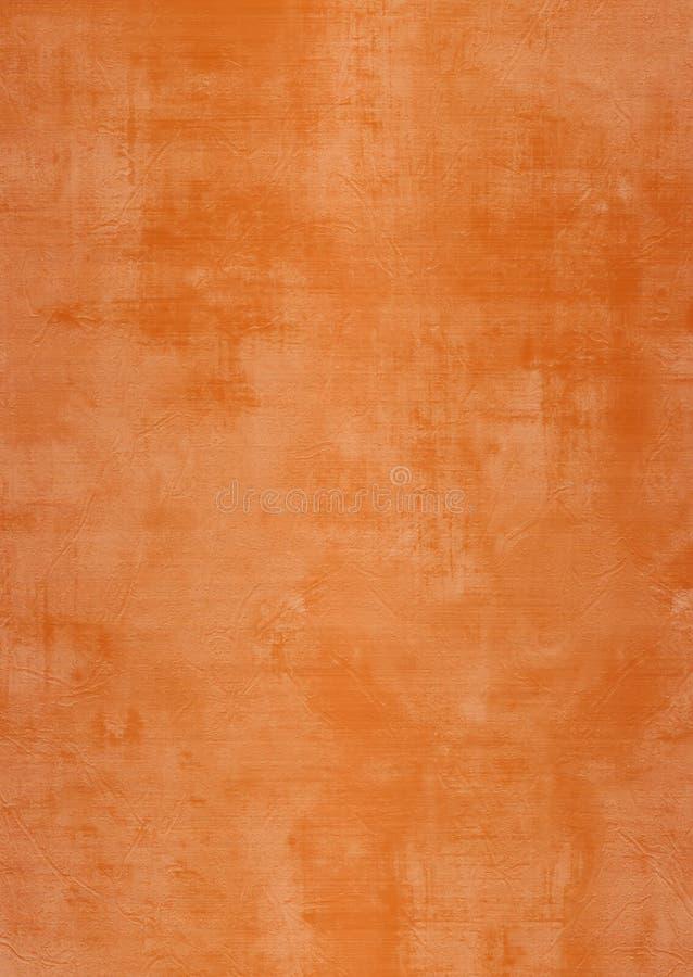 Parede marrom ou alaranjada de Grunge do emplastro com manchas fotos de stock