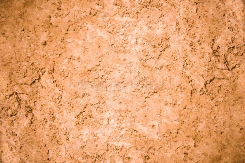 A parede rústica marrom do Grunge afligiu o fundo contínuo da textura fotografia de stock