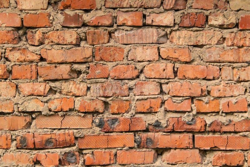 Parede Textured, expressivo de tijolos vermelhos foto de stock royalty free