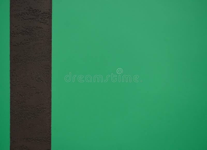 Parede verde do fundo com linha marrom fotografia de stock