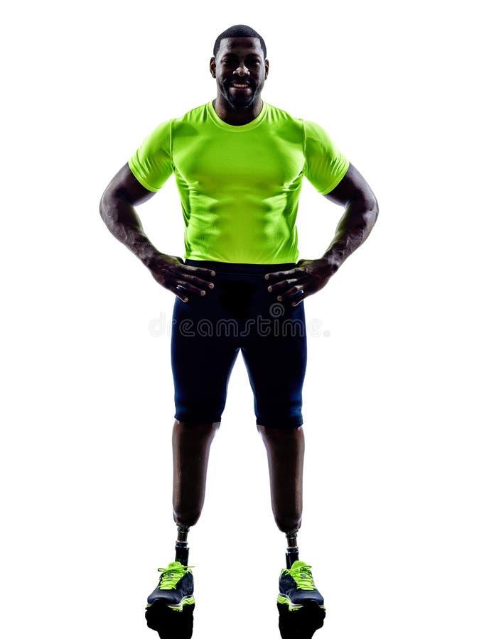 Pareggiatori handicappati dell'uomo con la siluetta della protesi delle gambe fotografia stock