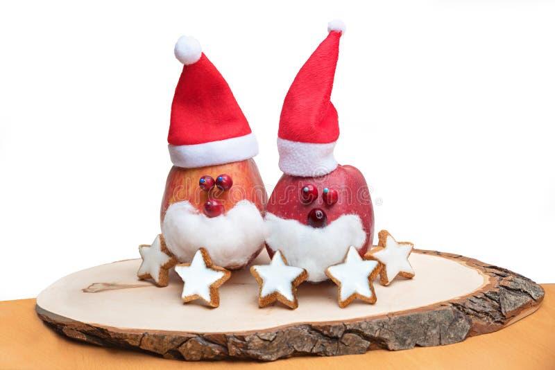 Pareja linda de Papá Noel con el sombrero, artesanía de los niños foto de archivo