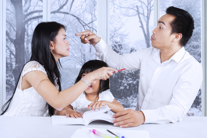 Parent arguing in front of daughter stock photography