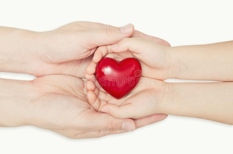 Parent and child holding heart in hand stock photography