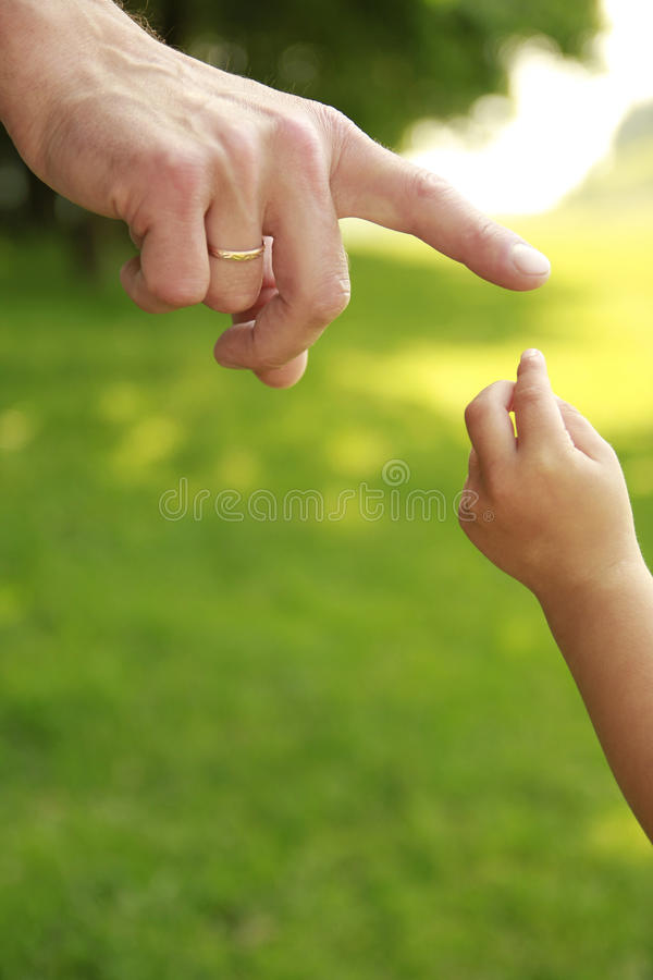 Parent Holds The Hand Of A Small Child Stock Photography