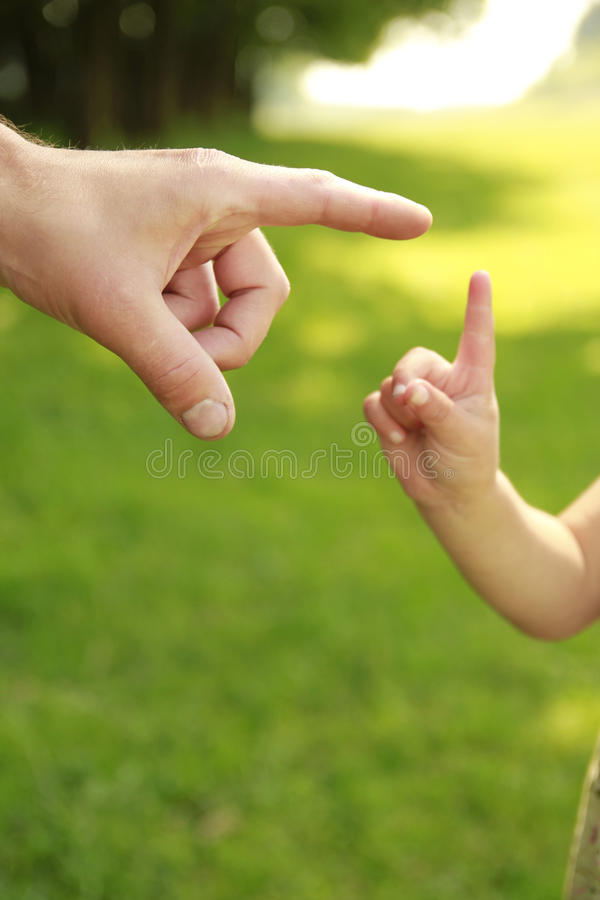 Download Parent Holds The Hand Of A Small Child Stock Photo - Image: 33703170