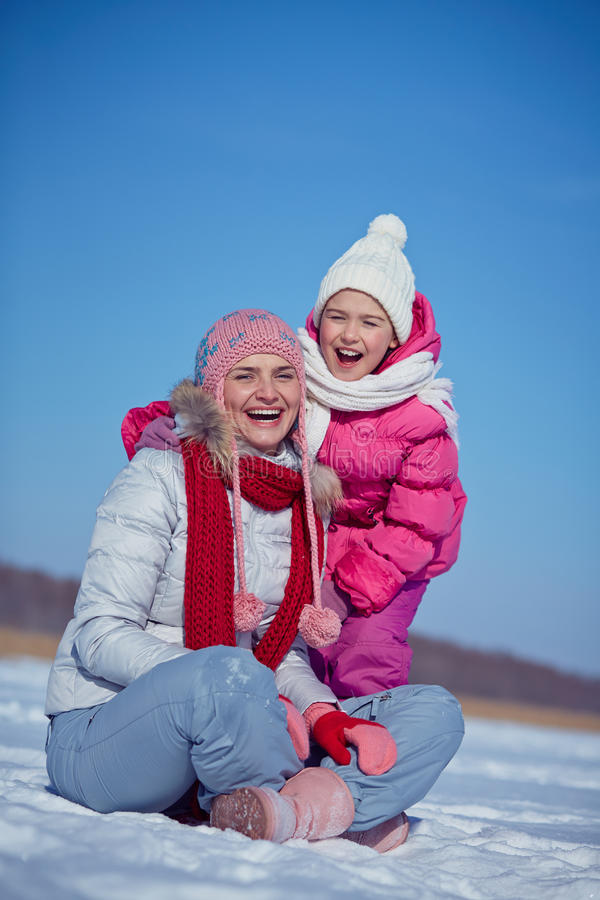 Parent and kid. Young women and her daughter laughing royalty free stock image