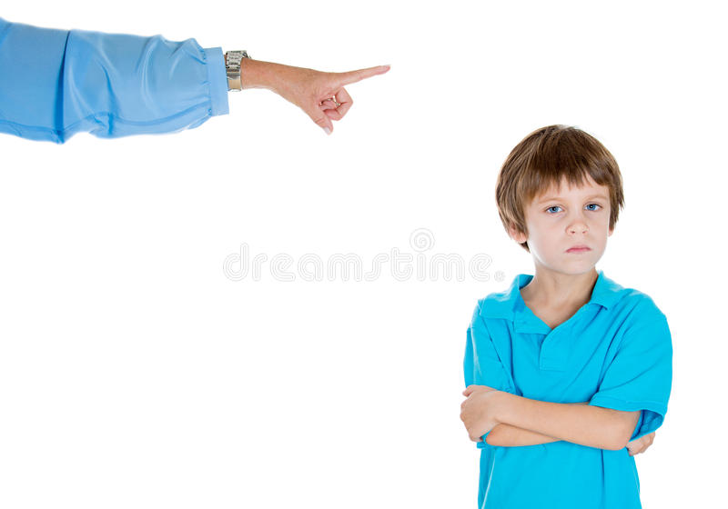 Parent pointing at a disobedient child royalty free stock image