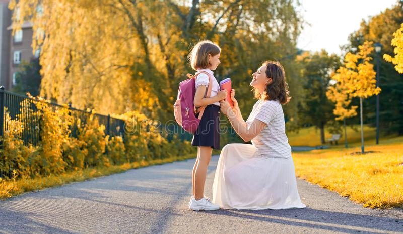 Parent and pupil go to school stock photo