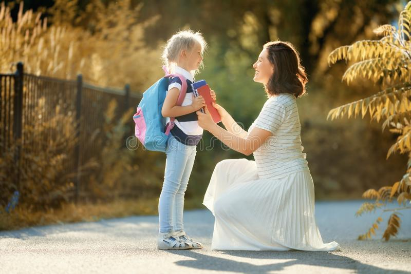 Parent and pupil go to school royalty free stock photography