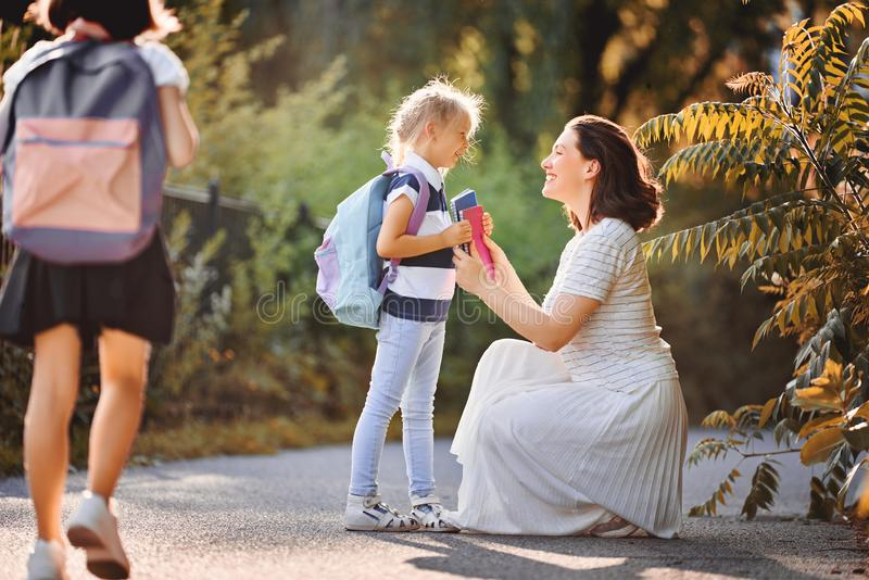 Parent and pupils go to school royalty free stock photography
