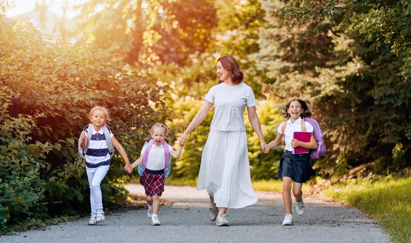 Parent and pupils go to school royalty free stock photos