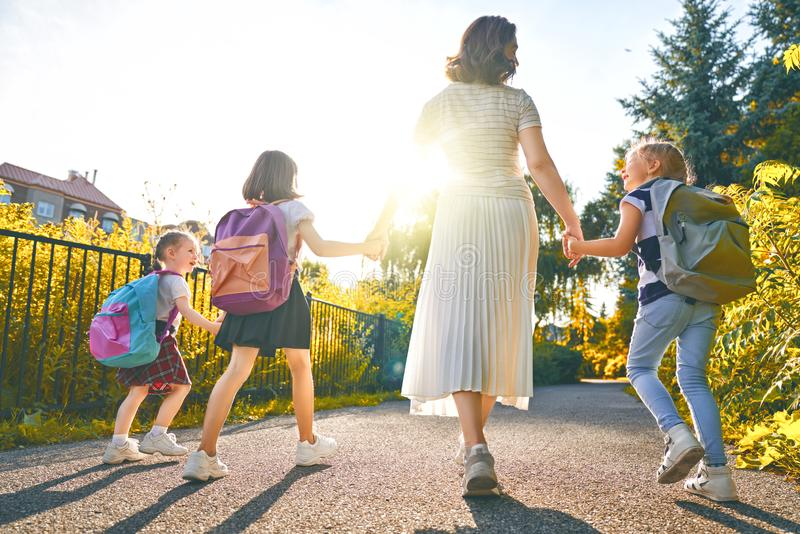 Parent and pupils are going to school stock photography